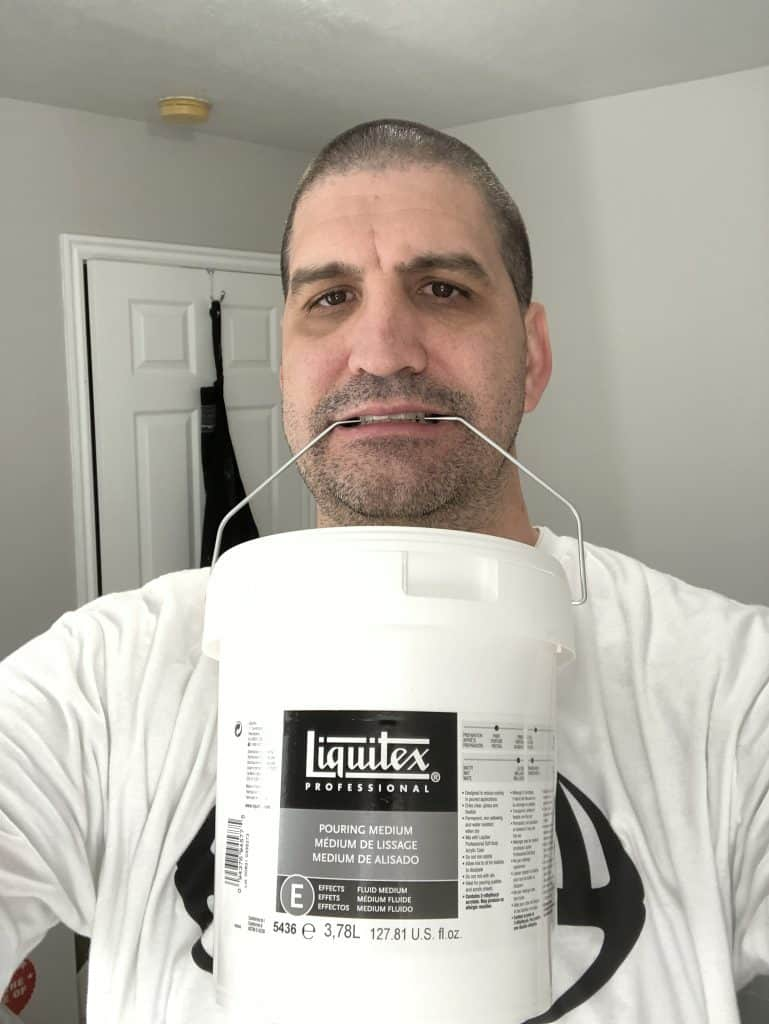 David holding Liquitex gallon